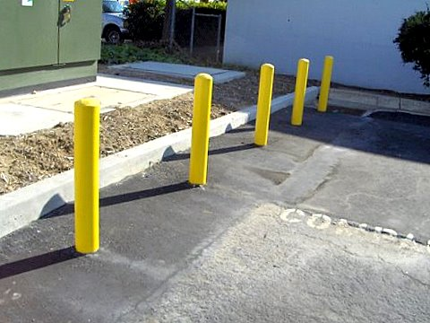Bollards in parking lot by LinePro Striping Nashville